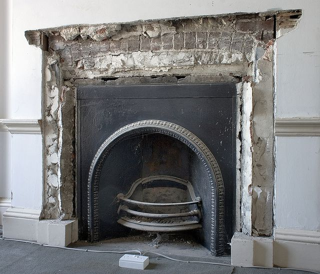Reinstated fireplace with exposed brickwork
